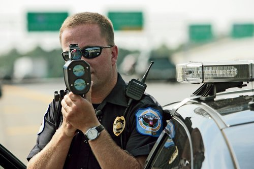Police officer shooting a lidar gun