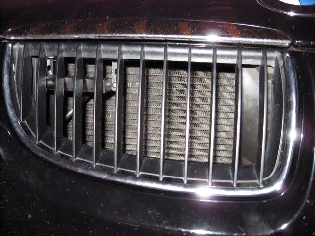 Laser jammer improperly installed behind a BMW grill