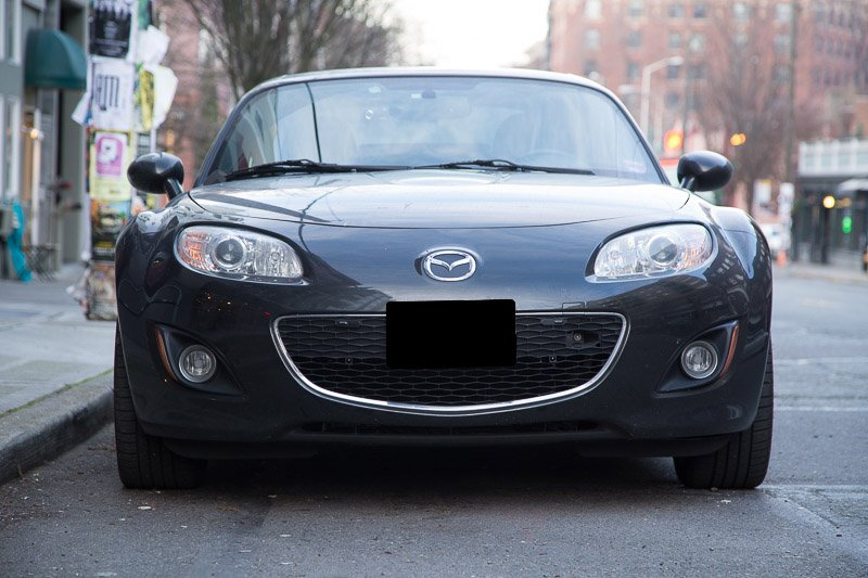 Stinger VIP (and AntiLaser Priority) jammer heads installed in the grill of my Miata