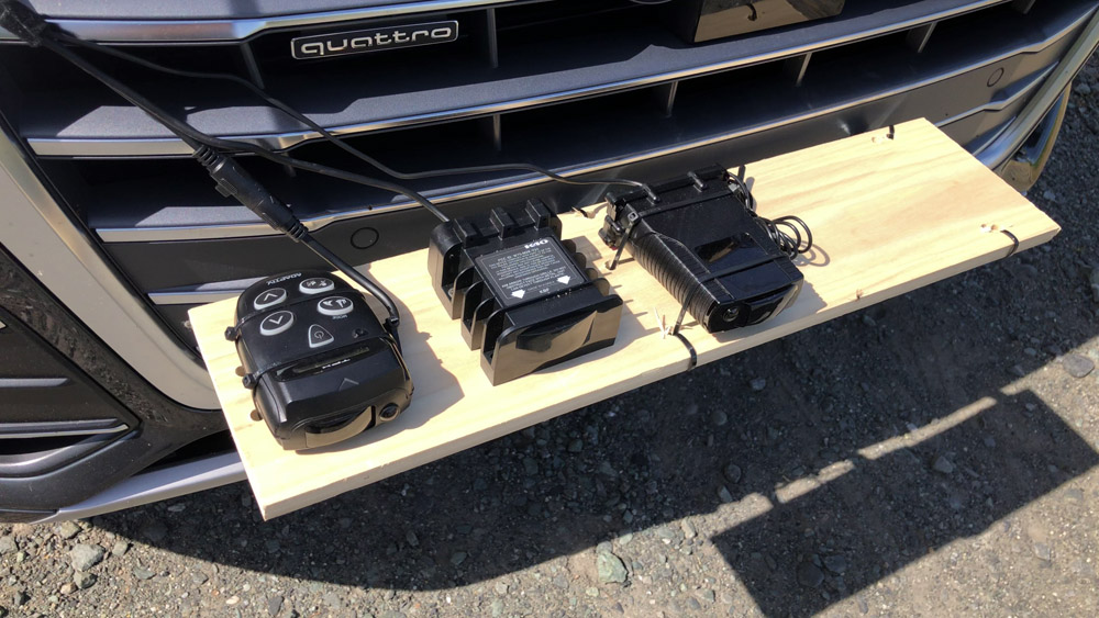 Radar detectors mounted on wooden mount on grill