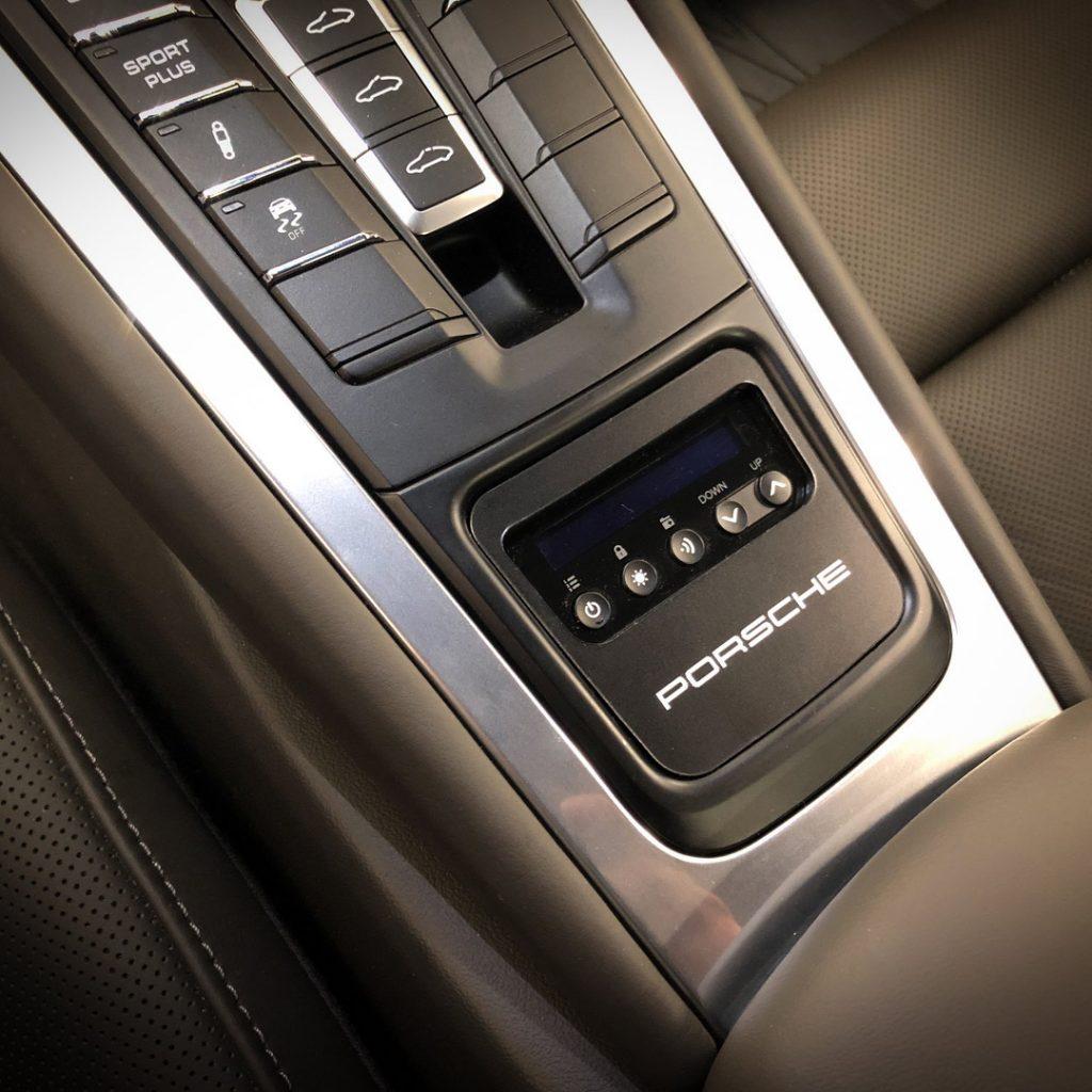 Radenso RC M installed in Porsche center console, by JK Automotive