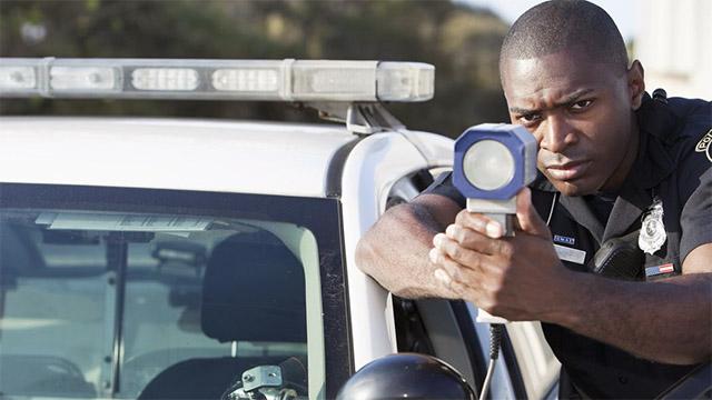 Officer shooting Kustom Talon radar gun