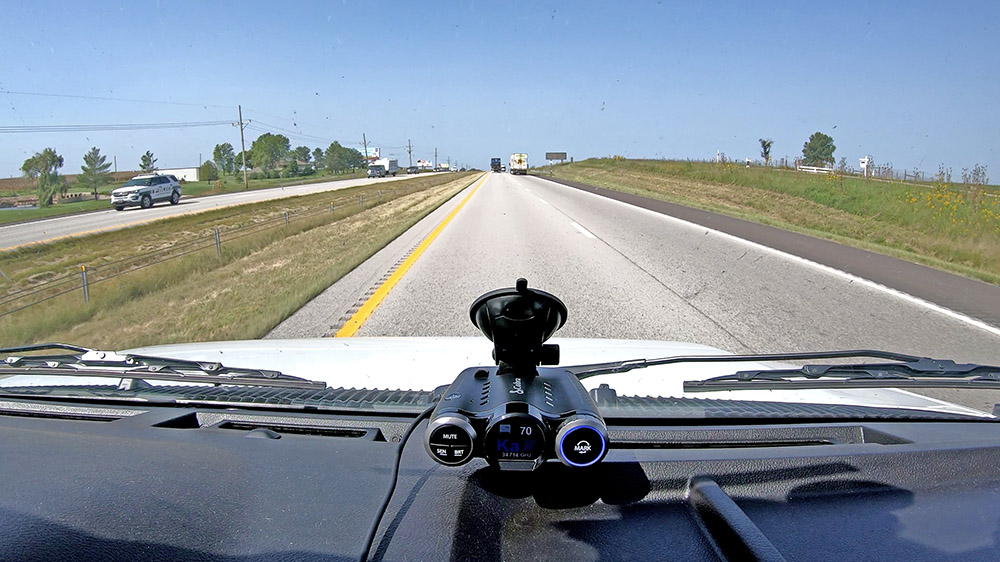 Road Scout alerting to officer shooting Ka on other side of highway